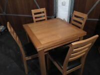 Extending Oak table with 4 chairs