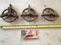 3 Antique cast iron pulleys and tightener