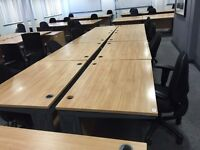 1.2 meter desks and black office chairs