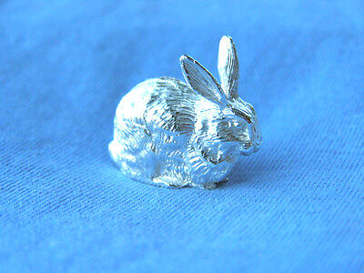 A MINIATURE HALLMARKED SOLID SILVER MODEL OF A RABBIT