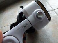Keplar VR headset with headphones built in.