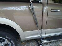 Slide in camper TIE DOWNS by TORKLIFT  front/rear