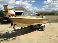 boat , motor and trailer 2200$ Obo or trade