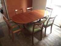 vintage reproduction extending dinning table and 6 chairs