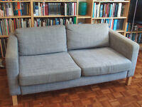Sofa. fabric covered . seats 3. Comfortable and supportive, low back
