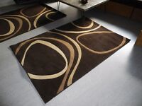 Brown rug nearly new 120 x 170 cm