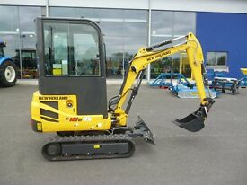 New Holland E18BSR with semi quick hitch, blade