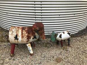 Two Rusted Metal Ornamental Garden Cows