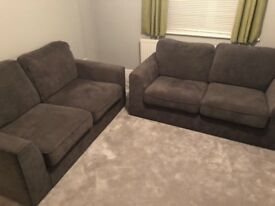 2 x 2 Seater grey fabric sofas with a footstool