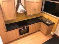 Oak wood effect kitchen units hob oven