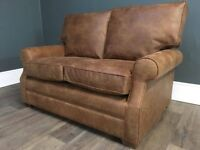 Beautiful, almost new, locally handcrafted saddle sofa