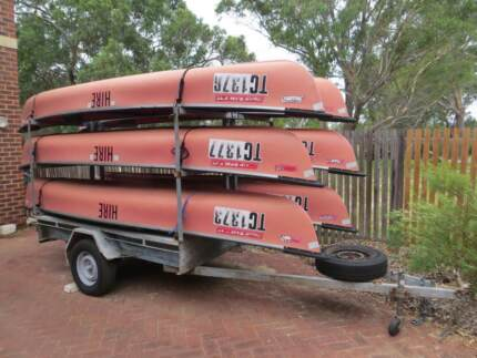 Six Coleman Canoes with Trailer, Paddles and Vests