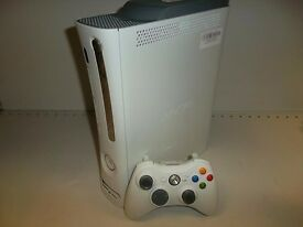 White Xbox 360 with 20GB hard drive, one controller and 12 games including GTA 5, and Portal 2