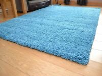 SHAGGY RUG BLUE CARPET NEARLY NEW 150 CM £20 DELIVERY AT EXTRA COST