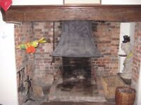 Antique large iron hood for open-fire fireplace grate.