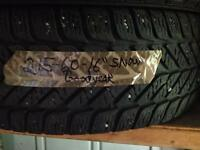 One Goodyear Ultragrip snow tire P215/60/16""