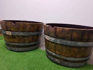 Half wine barrels on casters Brendale Pine Rivers Area Preview