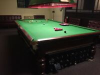Thurston full size snooker table complete with lock up box, light, scoreboard, cues and balls..