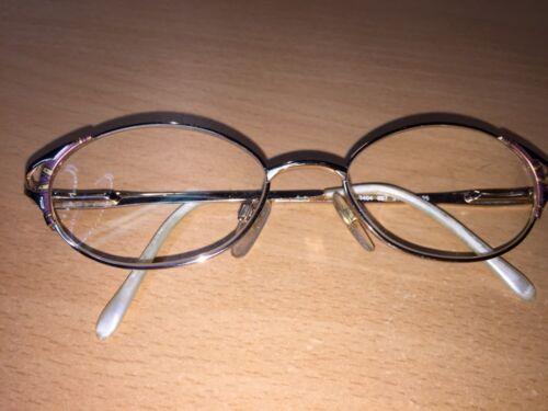 Optiker Damen Gleitsichtbrille, Gestell in Goldfarben mit Verzierungen,