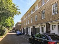 Deceptively spacious four bedroom town house built in a Neo Georgian style.
