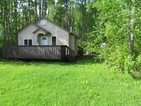 cabin and lot by the shores of slave lake for sale