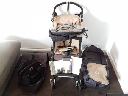 Bugaboo Cameleon with seat, bassinet, covers, and lots of extras.