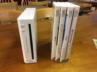Nintendo Wii With 5 Games & Two Wheels 3 Nunchucks 2 Controllers