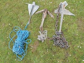 Three boat anchors plus five pulleys