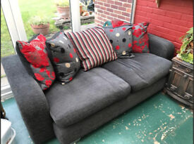 Sofa. Charcoal Black, 3 year old, seats 3-4 people. Good condition.