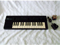 Yamaha PortaSound PSS-130 32-Key Portable Electronic Keyboard
