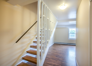 BEAT THE  FALL RUSH WITH THESE LARGE 2 LEVEL APARTMENTS!