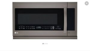 New Still in the box LG Black stainless Microwave