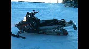2006 Polaris Switchback fst and a parts sled