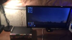 "24"" insignia tv/monitor with desk mounted arm and stock legs"