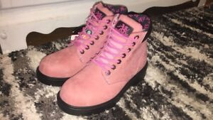Woman's pink steel toe boots never worn tags still on it!