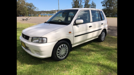 Mazda 121 white hatch back 2000