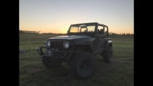 2001 Jeep TJ Sahara lifted on 33 s