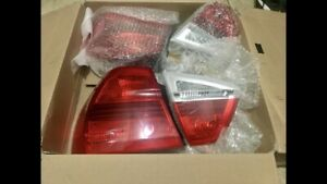 Authentic BMW Brand new tail light set (e90) +accessories!