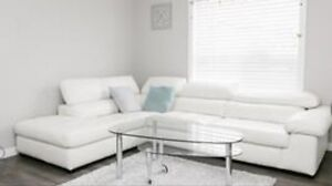 White leather L section sofa set
