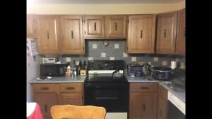 Kitchen cup boards, counter top and sink