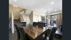 Solid timber table with six leather chairs Brookwater Ipswich City Preview
