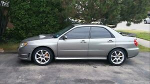 2006 Wrx with Sti 6 speed, Sti turbo, brembo brakes, etc