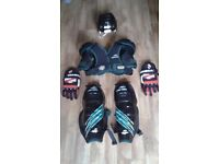 Street hockey protective helmet, gloves, shin and shoulder pads..
