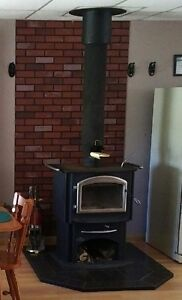 Napoleon Airtight Wood Stove w/ pipe and floor protector
