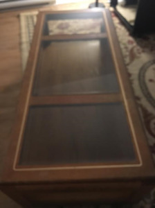 wooden dining set and glass top coffee table