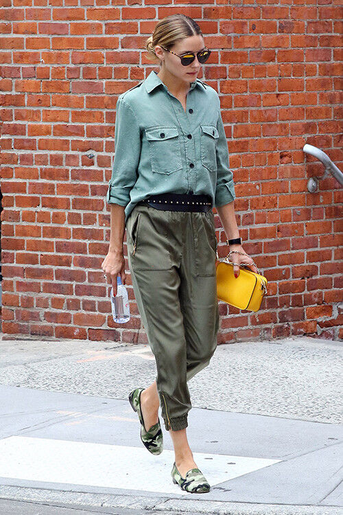Olivia Palermo in khaki trousers and camo loafers