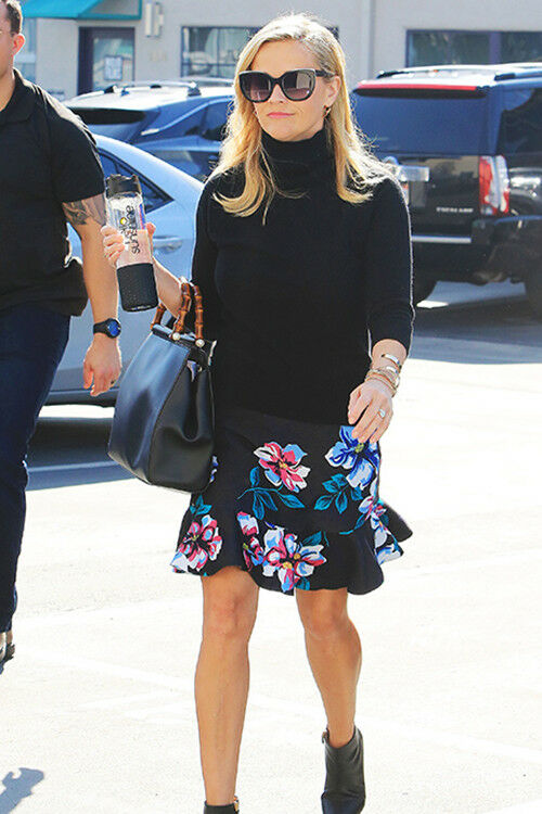Reese Witherspoon looks summery in a frilled floral skirt