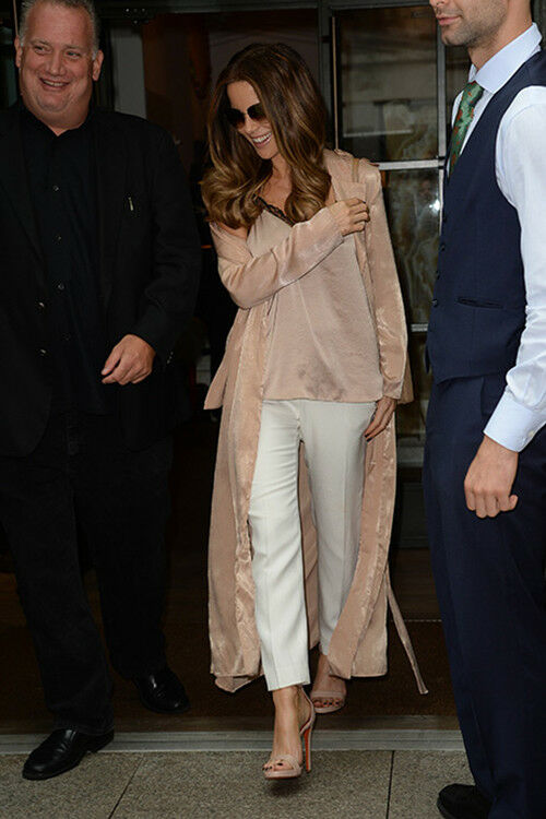 Kate Beckinsale wears a satin duster coat