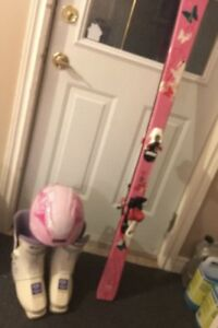 Skis boots and helmet