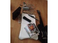 Black Wii one controller with motion plus, games Wii fit board and guitar hero